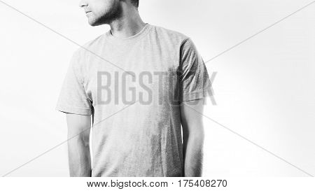 the guy in the blank grey, white  t-shirt, stand,  smiling on a white background, mock up, free space, logo, design, template for design print,