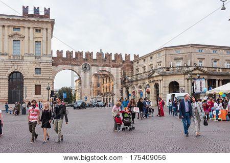 Tourists Walking Around Piazza Bra And I Portoni Della Bra