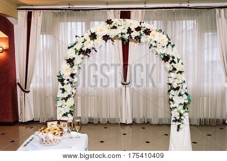Stylish Luxury Decorated Arch For The Celebration For A Wedding Of Happy Couple, Cathering In The Re