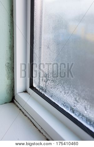 Close Up Of House Window With Damp And Condensation