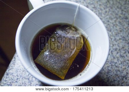 Infusion bag inside a cup with hot water