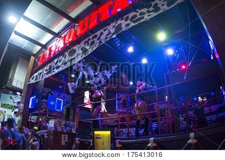 CANCUN MEXICO - FEBRUARY 28 2017: Go-go dancers perform nightly at the front of La Vaquita nightclub in Cancun to attract customers
