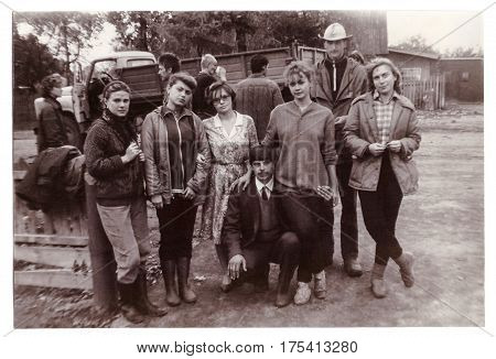 VITEBSK BELARUS - SEPTEMBER 1988: Students of Vitebsk medical institute on seasonal agricultural work in collective farm group photograph (vintage black and white photo 1988)