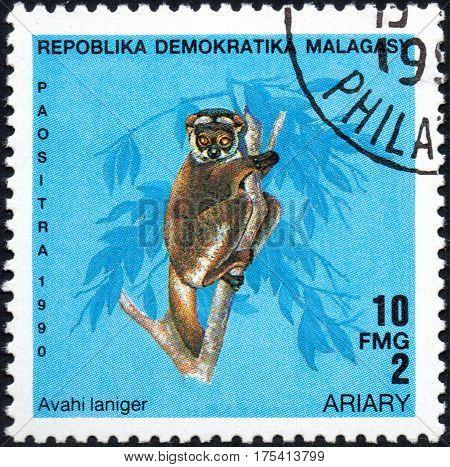 UKRAINE - CIRCA 2017: A stamp printed in Malagasy Madagascar shows Lemur Avahi laniger circa 1990