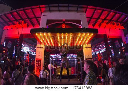 CANCUN MEXICO - FEBRUARY 28 2017: Go-go dancers perform at the entrance to Mandala nightclub in Cancun during the Spring break season