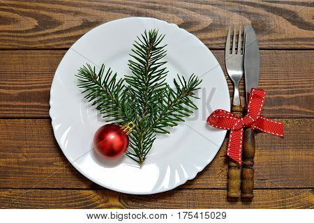 Christmas plate and silverware on wooden background