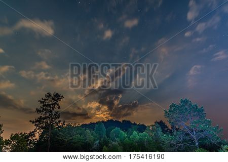 Starry sky view during moonrise in national park of Thailand