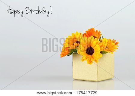 Happy Birthday card with marigold flowers in gift box