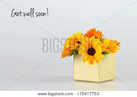 Get well soon card with marigold flowers arranged in gift box
