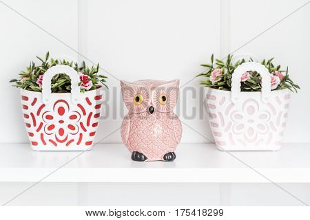 Decorative Pink Owl Moneybox And Trinket On White Shelf