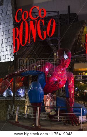 CANCUN MEXICO - MARCH 1 2017: A huge Spiderman figure kneels in landing position in front of the famous Coco Bongo nightclub in Cancun.