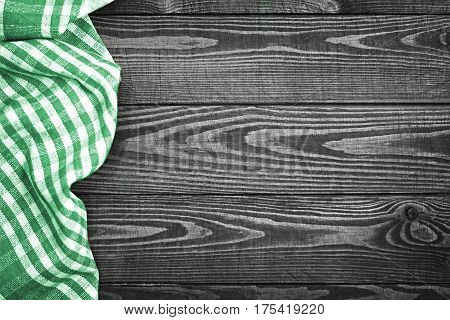 Cooking background with green checkered napkin on wooden board