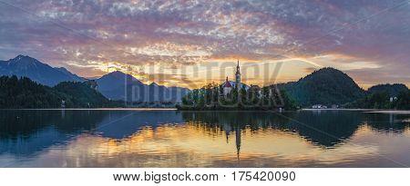 multicolored sunrise over the mountain lake in the Julian Alps Bled Slovenia