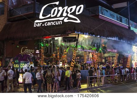 CANCUN MEXICO - MARCH 1 2017: The popularity of Cancun as a Spring break destination is partly due to the lively nightlife featuring attractive go-go dancers and open visibility of nightclub interiors.