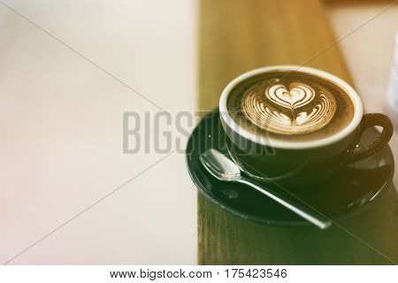 Coffee foam froth art on wooden table