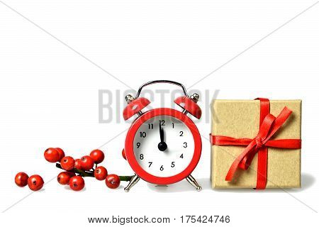 Midnight clock and gift box isolated on white background