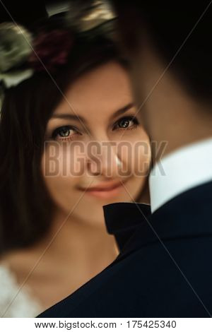 Luxury Happy Bride And Stylish Groom Hugging Each Other With Tender On Background Of  Sunny Rocks In