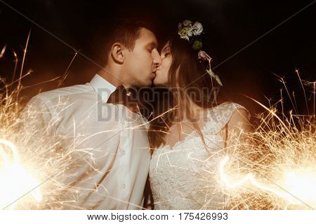 Happy Beautiful Bride And Elegant Stylish Groom Holding Fireworks On The Top Of A Mountains In The E