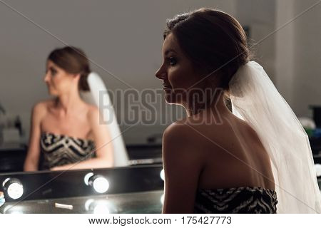 Stylish Gorgeous Bride Getting Makeup In The Luxury Beauty Saloon With Big Mirrors And Light