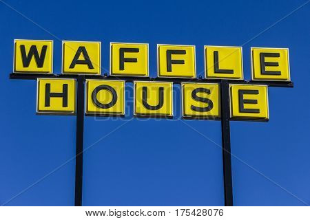 Muncie - Circa March 2017: Signage and Logo of Iconic Southern Restaurant Chain Waffle House. Waffle House was founded in 1955 I