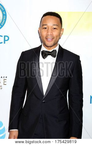LOS ANGELES - FEB 11:  John Legend at the 48th NAACP Image Awards Arrivals at Pasadena Conference Center on February 11, 2017 in Pasadena, CA