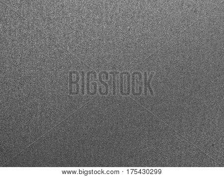 gray lacquered aluminum plate closeup / macro in the sunlight