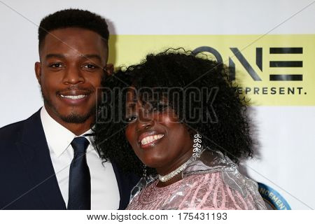 LOS ANGELES - FEB 11:  Stephan James, Mother at the 48th NAACP Image Awards Arrivals at Pasadena Civic Auditorium on February 11, 2017 in Pasadena, CA
