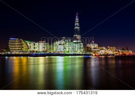 Night photo of City Hall and The Shard from Tower bridge, London, UK