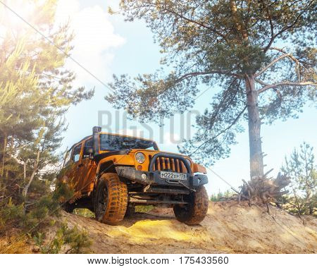 Leningrad region, Russia - June 10, 2016. Jeep Wrangler at a sand quarry in the Leningrad region, Wrangler is a compact SUV produced by Chrysler