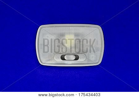 Interior light in car on blue color background.