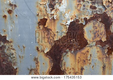 the background is a textured sheet metal with paint and rust