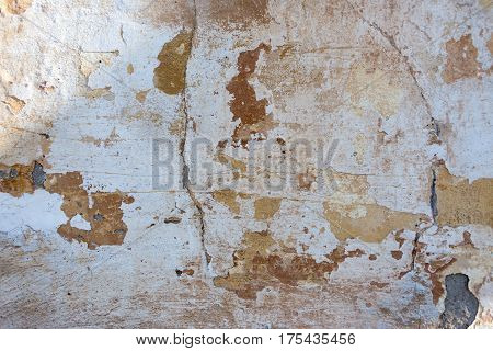 texture and background old wall cracks and peeling paint