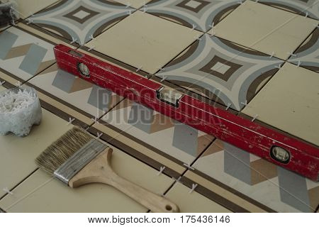 The Working Tool Of The Specialist For Laying Tiles, A Device For Determining The Level, A Brush, Cr