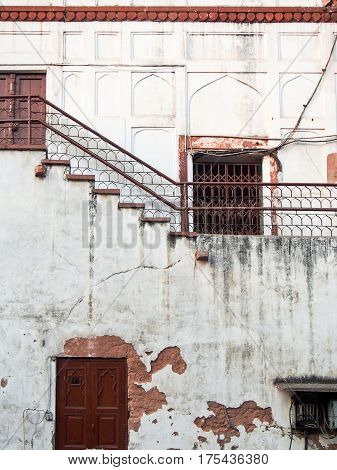 Cracked Weathered Building With Rusty Doors India