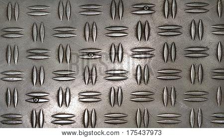 Texture of metal diamond plate close up