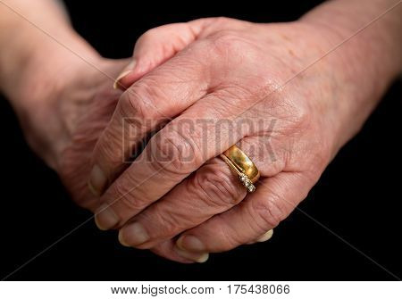 Close Up Of An Elderly Married Lady's Hands.