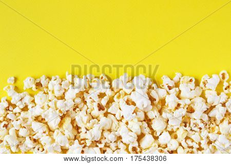 Movie theater popcorn on a yellow background