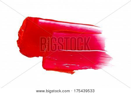 Red lipstick smudged on a white isolated background