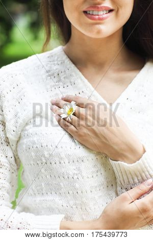 Happy pretty brunette woman in chamomile field cute female relaxed on flowers meadow spring nature having fun outdoor