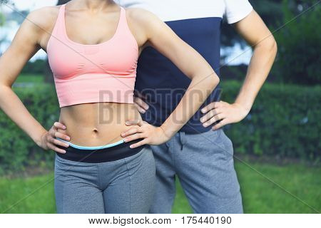Young couple exercising and stretching muscles before sport activity . Close up