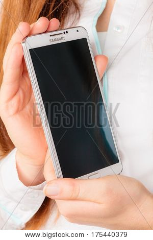 GDANSK POLAND - DECEMBER 4 2014: Samsung Galaxy Note 3 N9005 in female hands on December 4 2014 Poland. Samsung Group is a S. Korean multinational company and biggest competitor with Apples iphone.