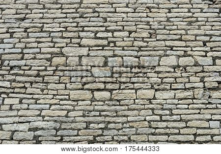Texture of ancient gray city wall in Pskov Russia