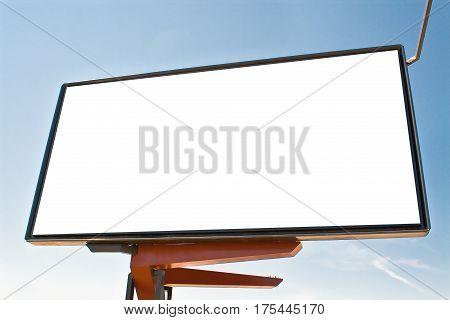 Big blank red billboard against blue sky