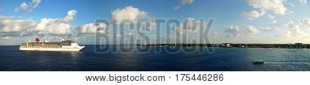 The panoramic view of cruise ship drifting near George Town on Grand Cayman island the popular port of call in Caribbean (Cayman Islands).