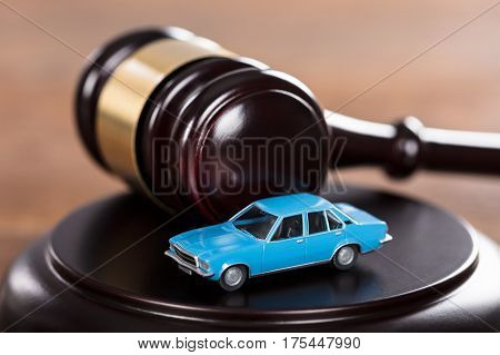 Close-up Of A Car Model Placed On The Mallet