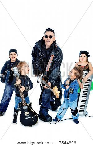 Heavy metal musician  with a group of stylish children. Shot in a studio. Isolated over white background.