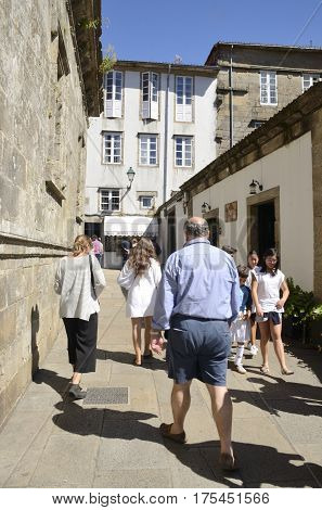 SANTIAGO DE COMPOSTELA, SPAIN - AUGUST 5, 2016: People on a street in the old town of the city in Santiago de Compostela Galicia Spain