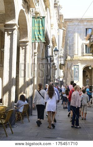 SANTIAGO DE COMPOSTELA, SPAIN - AUGUST 5, 2016: People on a central street in the old town of the city in Santiago de Compostela Galicia Spain