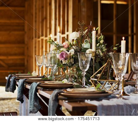 Decoration wedding table before a banquet. Bouquet and candles. Wedding party. Vintage Style.
