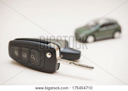 Car key, small car, money. buy or sell car
